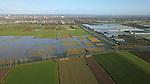 Foto: VidiPhoto<br /> <br /> BEMMEL &ndash; Luchtfoto van het 1700 ha grote Park Lingezegen en de aangrenzende bebouwing. In Park Lingezegen is er ruimte voor recreatie, natuur en landbouw. Het gebied is globaal gesitueerd tussen Arnhem (aan de Noordkant) en Nijmegen (aan de Zuidzijde), Elst (ten Westen van het park) en Bemmel (aan de Oostkant). Strak tegen het landschapspark aan - ten noordoosten- ligt Next Garden (het voormalige Bergerden), een ontwikkelingsgebied voor de tuinbouw. Aan de westkant wordt Park Lingezegen begrensd door de A325. Dwars door het natuurgebied loopt een snelfietspad.