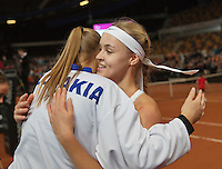 Februari 07, 2015, Apeldoorn, Omnisport, Fed Cup, Netherlands-Slovakia,  Anna Karolína Schmiedlová, (SLO) defeats  Kiki Bertens , and puts Slovakia in a 1-0 lead, and is congratulated by het teammates<br /> Photo: Tennisimages/Henk Koster
