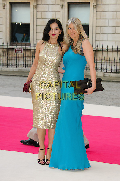 Yasmin Mills & Amanda Wakeley.Arrivals at the Royal Academy Summer Exhibition 2012 - preview party held at the Royal Academy of Arts, London, England..May 30th, 2012.full length black dress clutch bag gold sleeveless turquoise.CAP/CJ.©Chris Joseph/Capital Pictures.