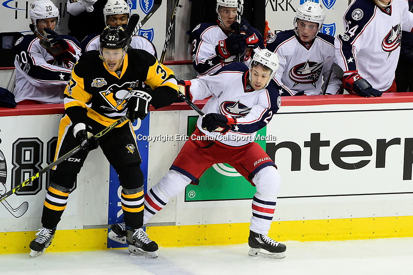 Wednesday, April 12, 2017: Columbus Blue Jackets right wing Oliver Bjorkstrand (28) and Pittsburgh Penguins right wing Carter Rowney (37) guard the blue line during game 1 of round one of the National Hockey League Eastern Conference Stanley Cup Playoffs between the Columbus Blue Jackets and the Pittsburgh Penguins, held at PPG Paints Arena, in Pittsburgh, PA.  Pittsburgh defeats Columbus 3-1. Eric Canha/CSM