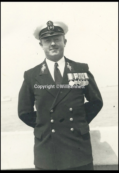 BNPS.co.uk (01202 558833)Pic: WillBennett/BNPS<br /> <br /> Heroic Petty Officer Ronald McKinlay in uniform and proudly displaying his medals.<br /> <br /> The incredible heroics of a navy commando who single-handedly took out two huge German guns on D-Day can be told after his prestigious gallantry medals were put up for auction.<br /> <br /> Petty Officer Ronald McKinlay was nominated to destroy one of the 88mm guns which he did by sneaking up close enough to hurl three hand grenades at it before taking the only surviving German prisoner.<br /> <br /> Later on that day, he braved sniper fire to drag to safety a wounded colleague lying face down in the dirt.<br /> <br /> After the war McKinlay became a Royal Navy frogman under the legendary 'Buster' Crabb and was a consultant for the John Mills film Above Us the Waves.