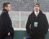 Matt Grzelcyk (BU - 5), Evan Rodrigues (BU - 17) - The University of Maine Black Bears defeated the Boston University Terriers 7-3 (2EN) on Saturday, January 11, 2014, at Fenway Park in Boston, Massachusetts.