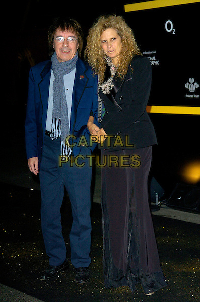 BILL WYMAN & SUZANNE WYMAN.Tutankhamun & The Golden Age O The Pharaohs - The Prince's Trust gala, The O2 Arena, London, England..November 14th, 2007.king tut full length blue black suit trousers jacket glasses scarf .CAP/CAN.©Can Nguyen/Capital Pictures