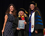 Reno Gazette-Journal TMCC Faculty Excellence in Teaching Award winner, Meeghan Gray, center, during the TMCC Graduation held at Lawlor Events Center in Reno, Nevada on Friday, May 11, 2018.