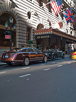 A vintage Bentley Blower and a flagship Mulsanne 2013 model parked outside the St Regis Hotel in New York