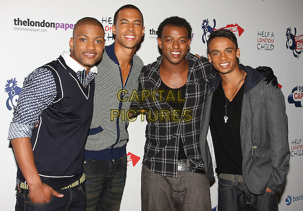 "JLS (aka Jack the Lad Swing).Capital FM Summertime Ball at the Emirates Stadium, London, England..June 7th, 2009.half length band group Aston Merrygold Marvin Humes Jonathan ""JB"" Gill Oritse Williams black grey gray cardigan top .CAP/ROS.©Steve Ross/Capital Pictures."