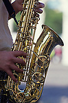 Musician playing saxophone on a street corner downtown Portland Oregon State USA