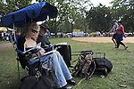 Revelers take to their sketch books on the lawn at the Pitchfork Music Festival in Union Park in Chicago, Illinois on July 19, 2009.