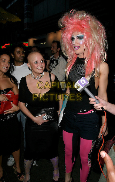 GAIL PORTER.Shadow Lounge Enchanted Party, The Shadow Lounge, London, UK..July 13th, 2006.Ref: AH.full length black leather skirt pink hair tights leggings cross dresser make up make-up.www.capitalpictures.com.sales@capitalpictures.com.© Capital Pictures.