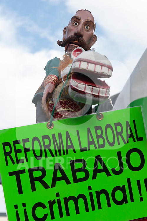 """Expression of the Spanish trade unions against cuts and closures of public services.Banner with the slogan """"Labour reform, criminal work""""..(Alterphotos/Ricky)"""
