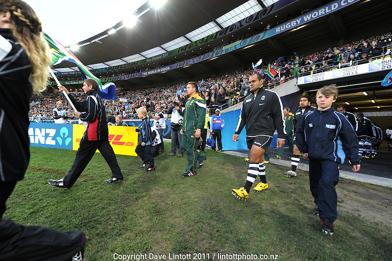 The teams walk out onto the pitch before the South Africa versus Fiji pool D match of the 2011 IRB Rugby World Cup at Wellington Regional Stadium, Wellington, New Zealand on Saturday, 17 September 2011. Photo: Dave Lintott / lintottphoto.co.nz