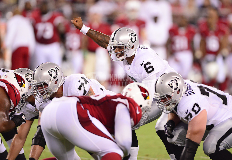 Aug. 17, 2012; Glendale, AZ, USA; Oakland Raiders quarterback (6) Terrelle Pryor calls a play against the Arizona Cardinals during a preseason game at University of Phoenix Stadium. The Cardinals defeated the Raiders 31-27. Mandatory Credit: Mark J. Rebilas-