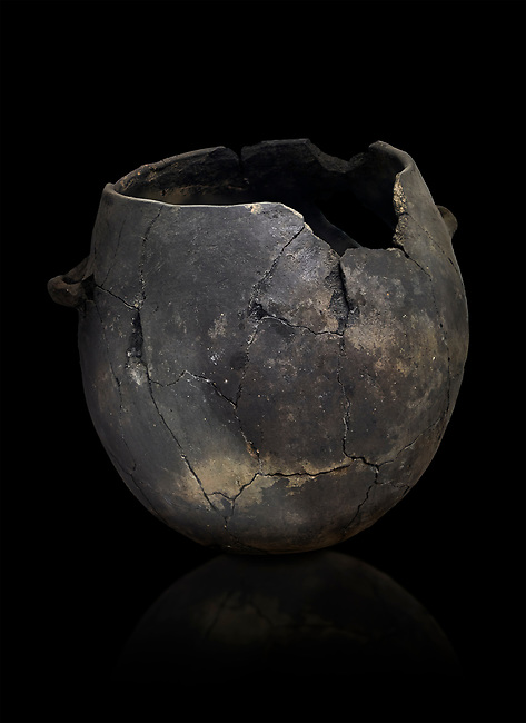 Neolithic terracotta pot . Catalhoyuk collection, Konya Archaeological Museum, Turkey. Against a black background