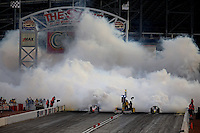 Mar 29, 2014; Las Vegas, NV, USA; NHRA jet car drivers race during qualifying for the Summitracing.com Nationals at The Strip at Las Vegas Motor Speedway. Mandatory Credit: Mark J. Rebilas-USA TODAY Sports