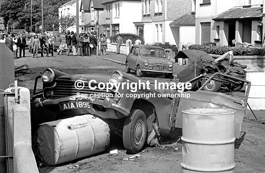 The scene of devastation in Causeway Road, Newcastle, Co Down, N Ireland, UK, after a Provisional IRA bomb exploded en route to a target. The bombers, an engaged couple, died instantaneously in the blast as their car was ripped apart. The incident happened just before midnight on 21st July 1973 in a quiet suburb of one of N Ireland's most popular seaside resorts. The couple, both 21 years, who died were Alphonsus Cunningham, from nearby Annalong, and Pauline Kane, from Castlewellan. 197307210513a<br /> <br /> Copyright Image from Victor Patterson, 54 Dorchester Park, Belfast, UK, BT9 6RJ<br /> <br /> t1: +44 28 9066 1296 (from Rep of Ireland 048 9066 1296)<br /> t2: +44 28 9002 2446 (from Rep of Ireland 048 9002 2446)<br /> m: +44 7802 353836<br /> <br /> e1: victorpatterson@me.com<br /> e2: victorpatterson@gmail.com<br /> <br /> The use of my copyright images is subject to my Terms &amp; Conditions.<br /> <br /> It is IMPORTANT that you familiarise yourself with them. They are available on my website at www.victorpatterson.com.<br /> <br /> None of my copyright images may be used on a website or on television unless they are visibly watermarked, i.e. &copy; Victor Patterson within the body of the visible image. The metadata of images used on the Internet must not be removed.<br /> <br /> Copyright acknowledgment of my images is a condition of use.<br /> <br /> Failure to observe the above conditions will incur a penalty of at least 100% of the agreed fee. <br /> <br /> Web use (maximum size - 400 kb) is extra at currently recommended NUJ rates.
