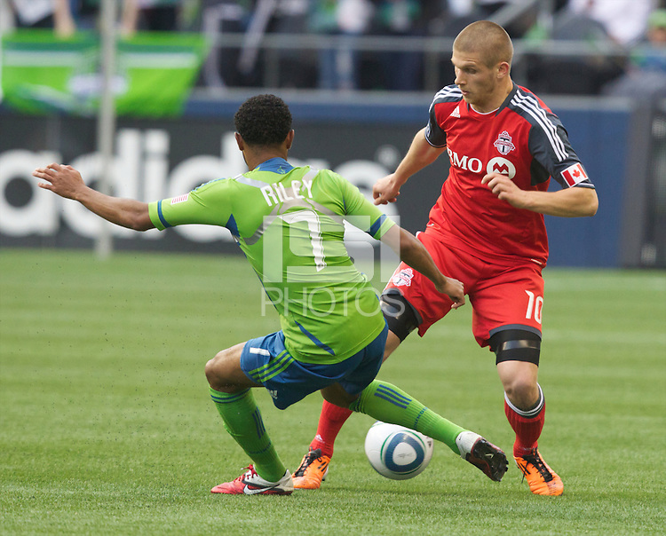 Toronto FC forward Alen Stevanovic changes direction against Seattle Sounders FC defender James Rileyduring play at Qwest Field in Seattle Saturday April 30, 2011. The Sounders won the game 3-0.