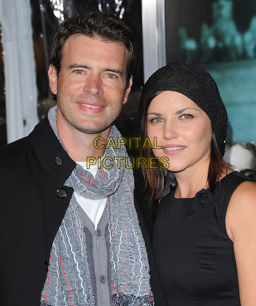 SCOTT FOLEY & wife.Premiere of Unknown held at The Regency Village Theatre in Westwood, California, USA..February 16th, 2011      .headshot portrait jacket dress scarf black grey gray.CAP/RKE/DVS.©DVS/RockinExposures/Capital Pictures.