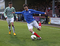 Ryan Hardie crossing watched by Glen Eadie in the Celtic v Rangers City of Glasgow Cup Final match played at Firhill Stadium, Glasgow on 29.4.13,  organised by the Glasgow Football Association and sponsored by City Refrigeration Holdings Ltd.