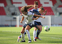 Paige Williams of England in action against Faustine Robert of France during the UEFA Womens U19 Final at Parc y Scarlets Saturday 31st August 2013. All images are the copyright of Jeff Thomas Photography-www.jaypics.photoshelter.com-07837 386244-Any use of images must be authorised by the copyright owner.