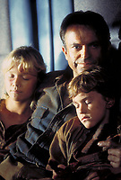 Jurassic Park (1993)<br /> Actor Sam Neill as Dr. Alan Grant, with Ariana Richards (left) and Joseph Mazzello (right) as Lex and Tim, in a scene from the film <br /> *Filmstill - Editorial Use Only*<br /> CAP/KFS<br /> Image supplied by Capital Pictures