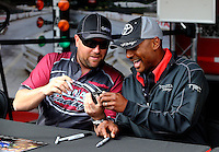 Sep 14, 2013; Charlotte, NC, USA; NHRA top fuel dragster driver Shawn Langdon (left) and Antron Brown during qualifying for the Carolina Nationals at zMax Dragway. Mandatory Credit: Mark J. Rebilas-