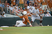 Texas Longhorns catcher Jacob Felts #12 slides into third base while Arizona State Sun Devls third baseman Riccio Torres #30 waits for the ball in NCAA Tournament Super Regional baseball on June 10, 2011 at Disch Falk Field in Austin, Texas. (Photo by Andrew Woolley / Four Seam Images)