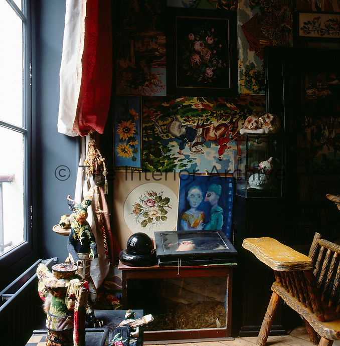 A detail of one of the rooms in the apartment of artist Frederique Morrel. The apartment where she lives is also her studio and a reflection of her work. She works with tapestry to create animal heads, human figures and other objects