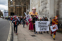 London, 23/02/2015. Today, the &quot;Justice Alliance&quot; and their Chris Grayling puppet dresses as King John Lackland arrived in Westminster for the last day of a tree-day march called &quot;Relay For Rights&quot; from Runnymede, birth place of the Magna Carta, to Old Palace Yard, where they held the &quot;Not the Global Law Summit&quot; rally. At the end of the demonstration outside the Houses of Parliament, protesters marched peacefully to the Queen Elizabeth II Centre where the &quot;Global Law Summit&quot; was taking place. From the organisers Facebook page: &lt;&lt; [&hellip;] February 23rd 2015 is the 799th and 8 month anniversary of the signing of the Magna Carta. The Government is using this non-anniversary to host the Global Law Summit, &quot;a unique opportunity to explore what the future holds for global business and the rule of law&quot;. This back-slapping corporate jamboree, partly funded by the Ministry of Justice, comes at a time when the same department has waged a slash-and-burn campaign on advice and representation, leaving people without deep pockets unable to get justice in court. Magna Carta represents the oldest historical commitment to equal access to justice in Britain. We are here to remind the Government of its duty to provide access to justice for all, and not merely to the rich. [&hellip;]&gt;&gt;<br /> <br /> For more information please click here: http://bit.ly/1G6aHZx