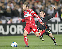 Kurt Morsink #6 of D.C. United comes in from behind to tackle Justin Mapp #21 of the Chicago Fire during an MLS match on April 17 2010, at RFK Stadium in Washington D.C. Fire won the match 2-0.
