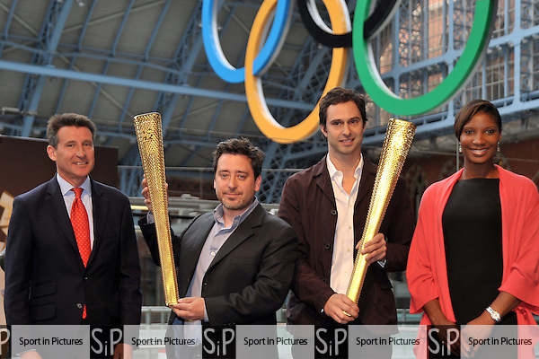 Sebastian Coe (Chairman of LOCOG, left) and Denise Lewis (right) with the designers of the torch. 2012 London Olympic Torch Prototype designed by Edward Barber and Jay Osgerby. St Pancras Station. London. 08/06/2011. MANDATORY Credit Sportinpictures/Garry Bowden - NO UNAUTHORISED USE - 07837 394578
