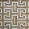 Theseus, a handmade mosaic shown in ceramic Ironwood, brushed Aluminum and honed Montevideo, is part of the Parterre Collection by Paul Schatz for New Ravenna.