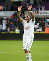 Skipper Ashley Williams salutes the crowd at the end of the match<br /> Re: Friendly match between Swansea City and  and Deportivo La Coruna 1st August 2015 at Liberty Stadium Swansea UK