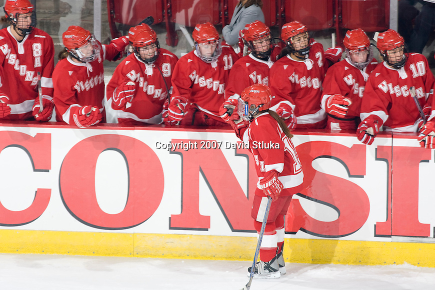 MADISON, WI - OCTOBER 5: The Wisconsin Badgers women's hockey team celebrates a goal against the Robert Morris Colonials at the Kohl Center in Madison, Wisconsin on October 5, 2007. The Badges beat the Colonials 3-0. (Photo by David Stluka).
