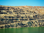 Sides and pond in the Berkeley Pit open pit copper mine in the city of Butte, Montana