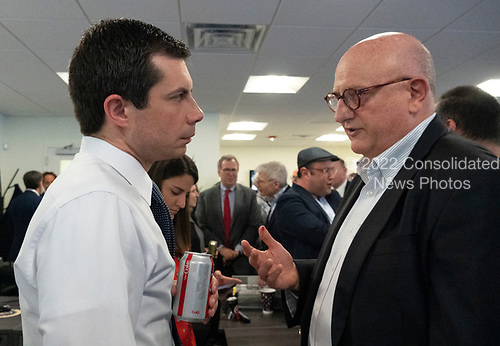 Ira Forman, former US Special Envoy for monitoring and combatting anti-Semitism, asks Mayor Pete Buttigieg a question following his meeting with leaders of the Jewish community at a communal parlor meeting at the offices of Bluelight Strategies in Washington D.C., U.S. on May 23, 2019.<br /> <br /> Credit: Stefani Reynolds / CNP