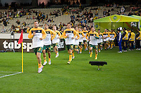MELBOURNE, AUSTRALIA - MAY 24, 2010: Lucas Neill leads the Qantas Socceroos onto the field at the FIFA World Cup farewell match against New Zealand at the Melbourne Cricket Ground, 24 May, 2010 in Melbourne, Australia. Photo by Sydney Low / www.syd-low.com