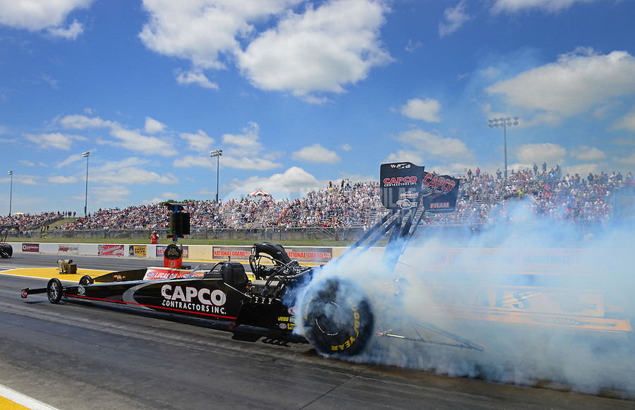 May 20, 2012; Topeka, KS, USA: NHRA top fuel dragster driver Steve Torrence during the Summer Nationals at Heartland Park Topeka. Mandatory Credit: Mark J. Rebilas-