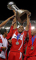 Chicago Fire defender Tony Sanneh (20) hoists the Dewar Cup.  The Chicago Fire defeated the LA Galaxy 3-1 in the championship of the U.S. Open Cup at Toyota Park in Bridgeview, IL on September 27, 2006.