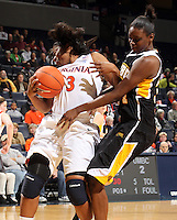 Dec. 18, 2010; Charlottesville, VA, USA; Virginia Cavaliers guard Paulisha Kellum (3) collides into UMBC Retrievers center Topé Obajolu (34) during the game at the John Paul Jones Arena.  Mandatory Credit: Andrew Shurtleff