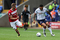 Bolton Wanderers' Josh Magennis breaks away from Bristol City's Adam Webster<br /> <br /> Photographer Andrew Kearns/CameraSport<br /> <br /> The EFL Sky Bet Championship - Bolton Wanderers v Bristol City - Saturday August 11th 2018 - University of Bolton Stadium - Bolton<br /> <br /> World Copyright &copy; 2018 CameraSport. All rights reserved. 43 Linden Ave. Countesthorpe. Leicester. England. LE8 5PG - Tel: +44 (0) 116 277 4147 - admin@camerasport.com - www.camerasport.com