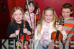VIOLIN: Young students of the violin who played at the Comhaltas in Tomaisins Bar, Lisselton, on Friday night were Ellie Leen (7), Niamh O'Sullivan (9), Aisling Madden (8), all Listowel, and David Sheehy (8), Lisselton.   Copyright Kerry's Eye 2008