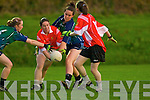 Northern Rangers duo.Breda Slattery (left).and Sinead Mackessy.prove a tough obstacle.for the East Kerry's.Aoife O'Sullivan in.their County Championship.final played at.Abbeydorney on Monday.night.