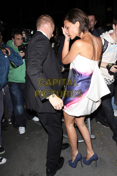 VICTORIA BECKHAM.The Vogue Dinner Party at La Caprice Restaurant, London, England..September 21st, 2009.full length strapless white purple yellow dip dye dress shoes silk satin back behind rear profile hand photographers paparazzi .CAP/AH.©Adam Houghton/Capital Pictures.