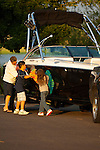 Family drying off boat
