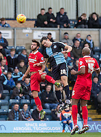 Luke O'Nien of Wycombe Wanderers & Jack Payne of Leyton Orient go up for the ball during the Sky Bet League 2 match between Wycombe Wanderers and Leyton Orient at Adams Park, High Wycombe, England on 23 January 2016. Photo by Andy Rowland / PRiME Media Images.