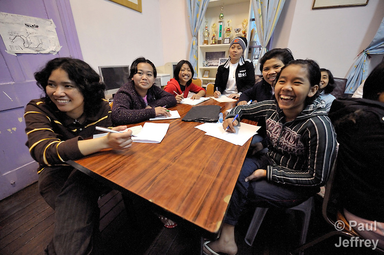 At Bethune House Migrant Women's Refuge, a ministry with migrant domestic workers in Hong Kong, women participate in an English class.