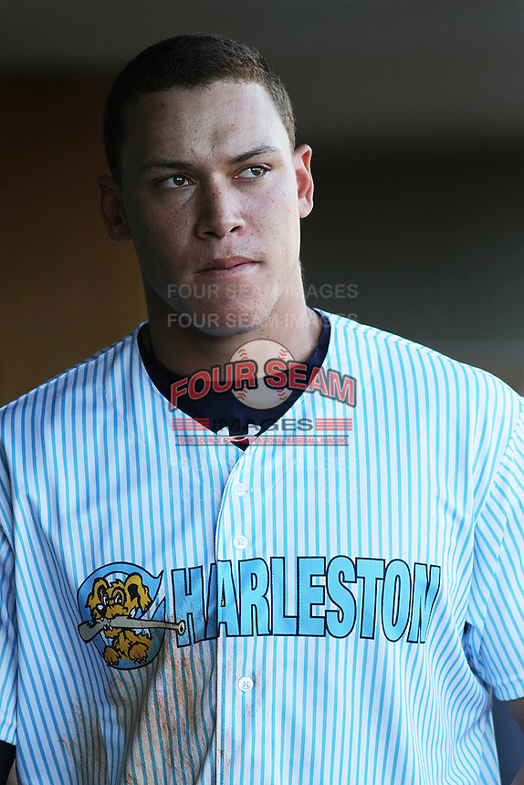 Charleston RiverDogs outfielder Aaron Judge #35 in the dugout during a game against the Augusta GreenJackets  at Joseph P. Riley Jr. Ballpark  on April 13, 2014 in Charleston, South Carolina. Augusta defeated Charleston 2-1. (Robert Gurganus/Four Seam Images)