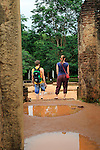 Tourists exploring UNESCO World Heritage Site, the ancient city of Polonnaruwa, Sri Lanka, Asia - ruins at Potgul Vihara site