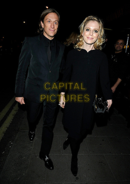 "JEREMY GILLEY & EMILIA FOX.Leaving ""A Single Man"" Film Premiere, at The Curzon Mayfair, London, England..February 1st, 2010.departures full length couple black suit coat jacket holding hands .CAP/CAN.©Can Nguyen/Capital Pictures."