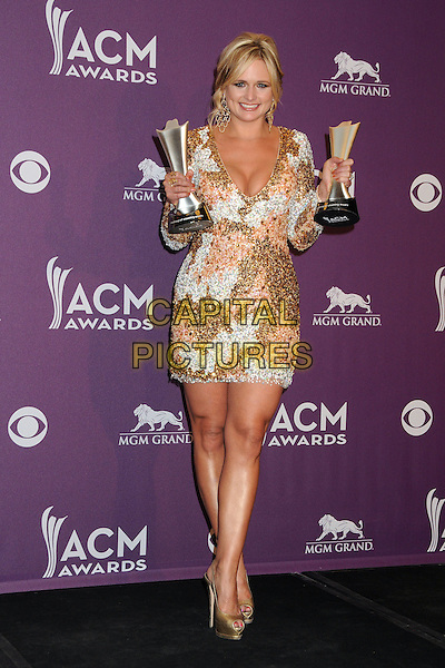 Miranda Lambert.47th Annual Academy of Country Music Awards - Press Room held at the MGM Grand, Las Vegas, Nevada, USA..April 1st, 2012.ACM CMA full length white dress winner award trophy trophies gold pink beads beaded cleavage    .CAP/ADM/BP.©Byron Purvis/AdMedia/Capital Pictures.